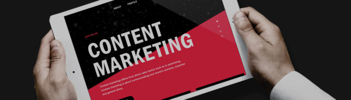 The words content marketing on a tablet